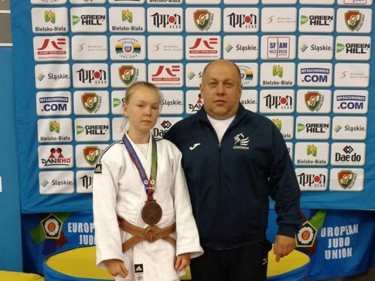 Катерина Пилипюк із тренером із дзюдо Олександром Сікорським.